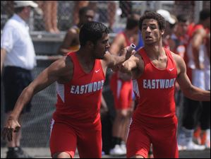 Tim Hoodlebrink hands off to Gabe Fredericks   in the Boys 4x400 meter relay.