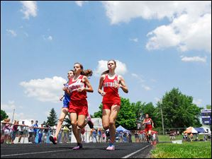 Bellevue's Michaela Fox and Eastwood's Sarah Bettinger keep stride as they compete in the girls 1600 meter run.