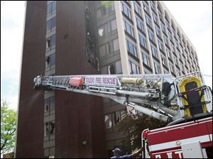 Streets near the hotel on South Reynolds Road were temporarily closed as firefighters worked to put out the fire that started about 11:40 a.m. in a fourth-floor utility room and spread to the three floors above.