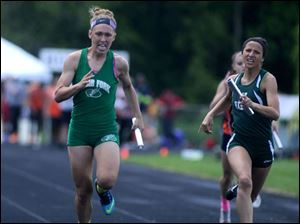 Clear Fork's Jordyne Helinski edges out Athena Eli of Oak Harbor to win the girls 4x200 meter relay.