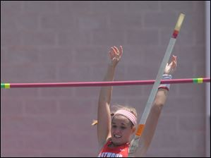 Eastwood's Elise Wolff clears her jump in the pole vault.