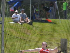 Eastwood's Brittany Brittian competes in the girls discus throw.