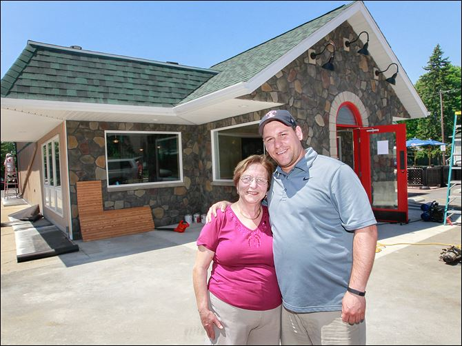 2n2grant Maddalena Zanger and her son Stefano Zanger, outside of Lena's Italian Restaurant, used some of their first grant award  to resurface the front of their restaurant in fieldstone and construct a vestibule.