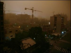 A view of Tehran, Iran, today while a flash dust storm hits the Iranian capital.