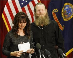 Jani and Bob Bergdahl speak to the media during a press conference at Gowen Field in Boise, Idaho, on Sunday. Bob Bergdahl, the father of an American soldier just released from captivity in Afghanistan says he's proud of how far his son, Sgt. Bowe Bergdahl, was willing to go to help the Afghan people.