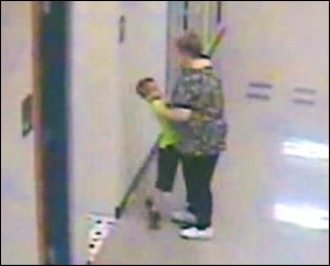 A Riverdale teacher, Barb Williams, has been suspended for 10 days after a security camera showed her pushing the student against a wall and then lifting him up by his shirt and face.