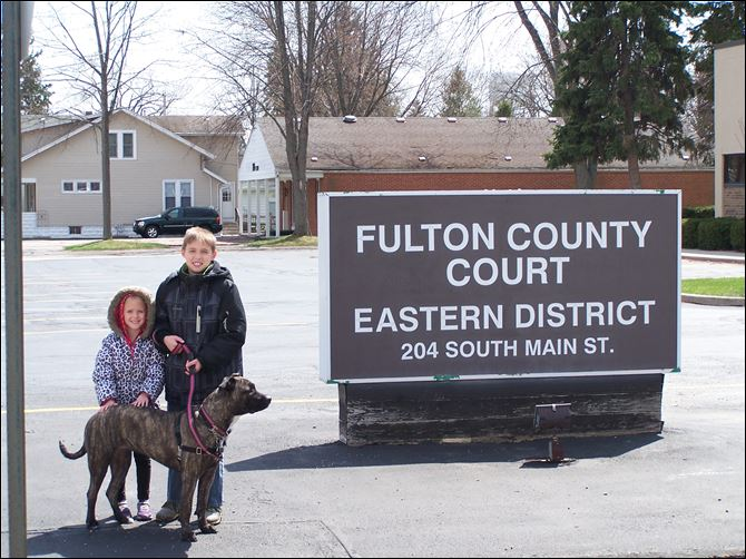CTY Swanton Dog1.JPG 6-2 Tyler Bork, 11, right, and Kayla Bork, 6, with Bailey. Their father, Tim Bork, had been in court over charges stemming from his refusal to register Bailey with the city of Swanton's