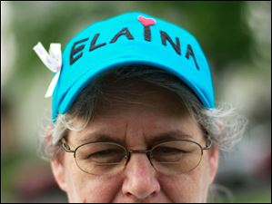 Dona Brown, Elaina's great aunt, stands for a portrait to show her hat in honor of the little girl.