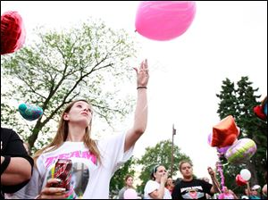 Ruth Lewis, left, and her daughter Tiffany Lewis, right, release a balloon as well as others including Michelle Allen, back left, and her daughter Brittany Allen, back right, for a balloon launch.
