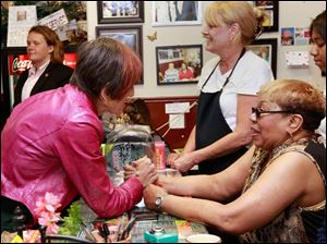 Rosa DeLauro, congresswoman from Connecticut 3rd Congressional District, left, meets Ruby Butler during the Women on a Roll bus tour that stopped at Ruby's Kitchen in Toledo. Butler is the owner of Ruby's Kitchen.