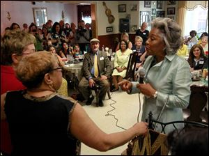 Joyce Beatty, member of Congress from Columbus, right, talks to Ruby Butler, center. Ruby, owner of Ruby's Kitchen, has her arm around Congresswoman Marcy Kaptur.
