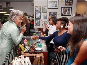 Joyce Beatty, a member of Congress from Columbus, left, talks to women.