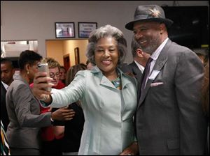 Joyce Beatty, member of Congress from Columbus, takes a selfie with Toledo city councilman Larry Sykes.