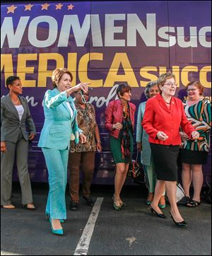 U.S. Rep. Nancy Pelosi (D., Calif.), front left, and Rep. Marcy Kaptur (D., Toledo), front right, accompany other representatives to promote women's success.