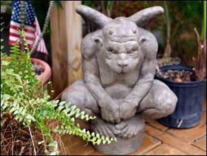 A gargoyle guards the backyard garden behind the Historic St. Patrick's Church.