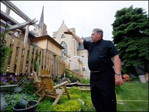 Father Christopher Vasko, a Catholic priest at Historic St. Patrick's, in the backyard.