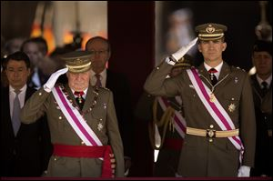 King Juan Carlos and Crown Prince Felipe, right, attend a military ceremony in San Lorenzo de El Escorial, outside Madrid, Spain, on June 3, 2014.