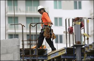 A construction worker works on the site of the SoMa at Brickell apartment building in downtown Miami.