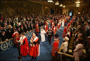 Britain's Queen Elizabeth II, center left,  and Prince Philip, center right,  proceed through the Royal Gallery during the State Opening of Parliament in the House of Lords at the Palace of Westminster in London.