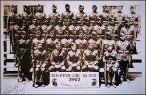 In this photo provided by the Nez family, Chester Nez, standing front left, of Albuquerque, N.M., poses with the first group of Navajo code talkers in 1942 in San Diego.