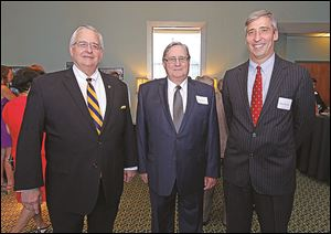 Joseph Zerbey, left, Dr. Lloyd Jacobs, center, and Dave Morlock, during the 50th anniversary celebration of the founding of the Medical College of Ohio at the University of Toledo Medical Center.