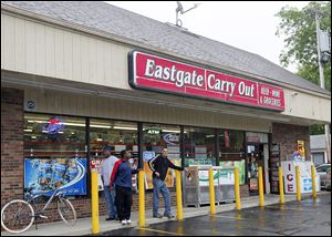 The Eastgate Carry Out store was robbed on Tuesday, the 12th carryout burglary in Toledo since May 1. Police have not released descriptions of the suspects, nor images from surveillance video.