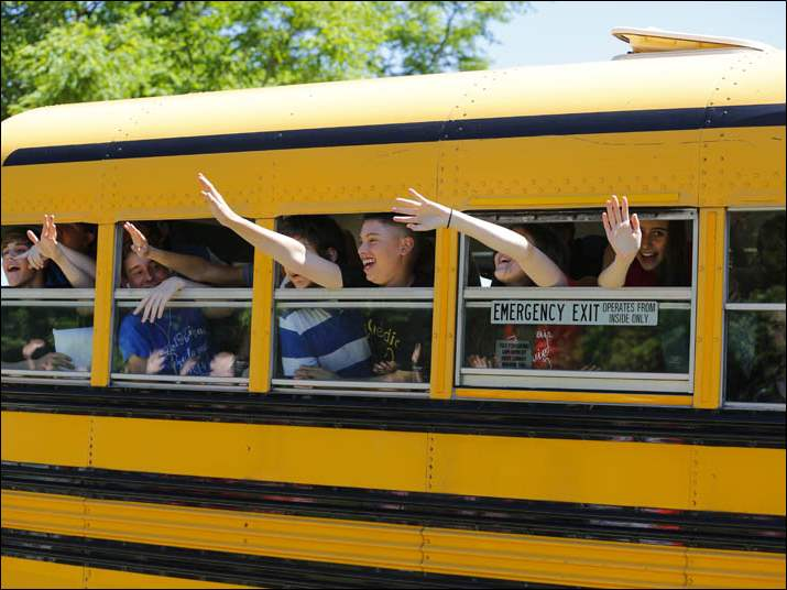 Students wave goodbye to teachers   during the last day of school at McCord Junior High School, Thursday, June 5, 2014.