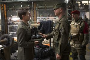 Tom Cruise and Bill Paxton in a scene from 'Edge of Tomorrow.'