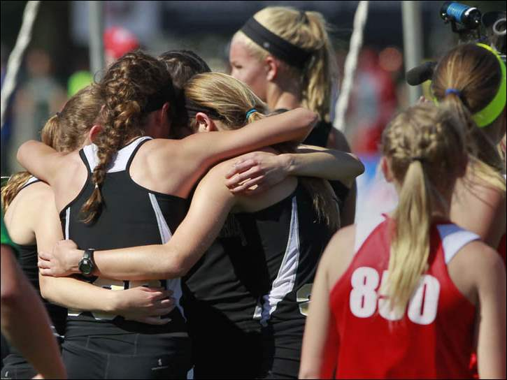 Perrysburg's Div. 1 4x800 meter relay team hug after winning a state title.