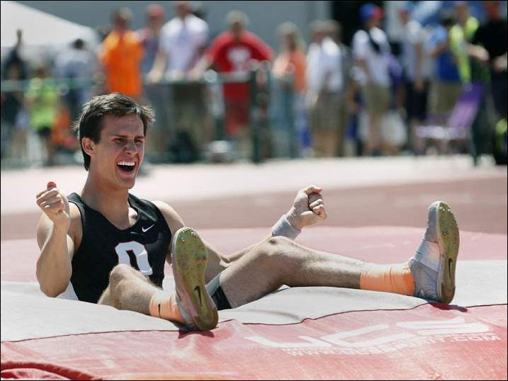 "Otsego's Cole Gorski reacts to clearing 16' 2"" to win the Div. II pole vault event."