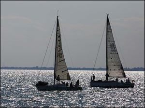 Two boats wait for their race near the start line of the Mills Trophy Race.