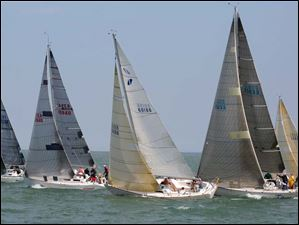 Boats in the Mills Trophy Course PHRF B class cross the start line during the Mills Trophy Race, Friday.