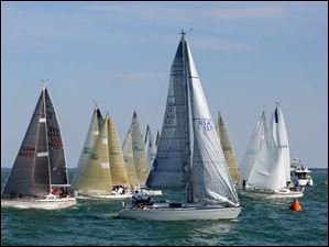 Having crossed the start line early, the Ariel, sail number USA 137, owned by George Steinemann of Sandusky, is forced to make a penalty turn back around the start of the Governor's Cup Course.
