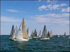 Boats in the President's Trophy Course cross the start line during the Mills Trophy Race.