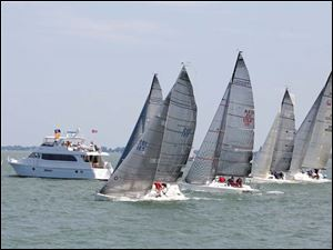 Boats in the Mills Trophy Course PHRF A class cross the start line during the Mills Trophy Race, Friday.