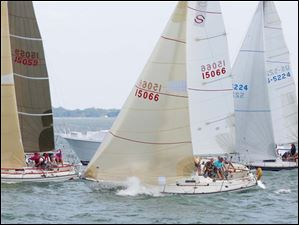Sailboats in the PHRC C&D class of the  Mills Trophy Course cross the start line.