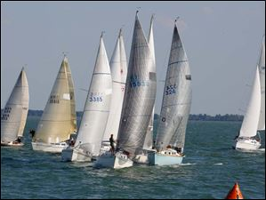 Boats in the President's Trophy Course tack to the start during the Mills Trophy Race.