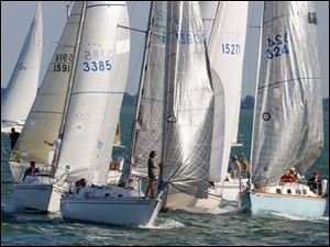Boats in the President's Trophy Course tack to the start during the Mills Trophy Race, Friday.
