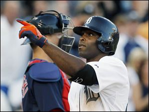 Torii Hunter points to the stands after hitting a solo home run.