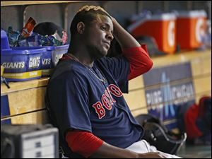 Boston Red Sox pitcher Rubby De La Rosa sits on the bench after being relieved against the Detroit Tigers in the sixth inning.