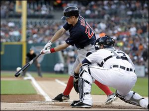 Boston Red Sox's Brock Holt hits a single off Detroit Tigers pitcher Drew Smyly.
