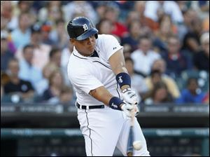 Miguel Cabrera singles against the Boston Red Sox.