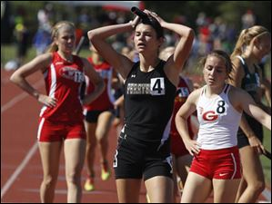 Perrysburg's Courtney Clody takes a breather after anchoring her Div. 1 4x800 meter relay team to 1st place.