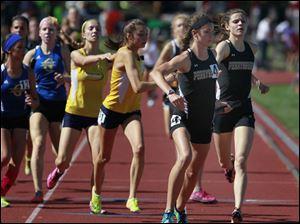 Perrysburg anchor Courtney Clody takes the baton from Alexis Kemp in the Div. 1 4x800 meter relay.