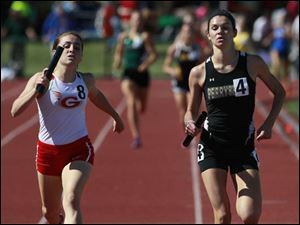 Geneva's E. Deering, left, is bested by Perrysburg's Courtney Clody in the Div. 1 4x800 meter relay.