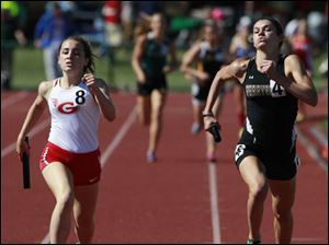 Geneva's Emily Deering, left, is bested by Perrysburg's Courtney Clody at the finish line in the Division 1 4x800 meter relay.