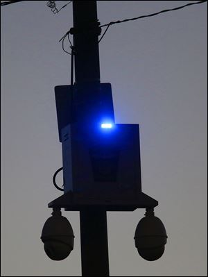 This police camera at Starr Avenue and East Broadway in East Toledo is among 147 installed across the city.
