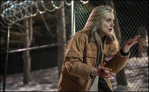Taylor Schilling in a scene from '‍Orange is the New Black.' The second season of the prison series became available Friday on Netflix.