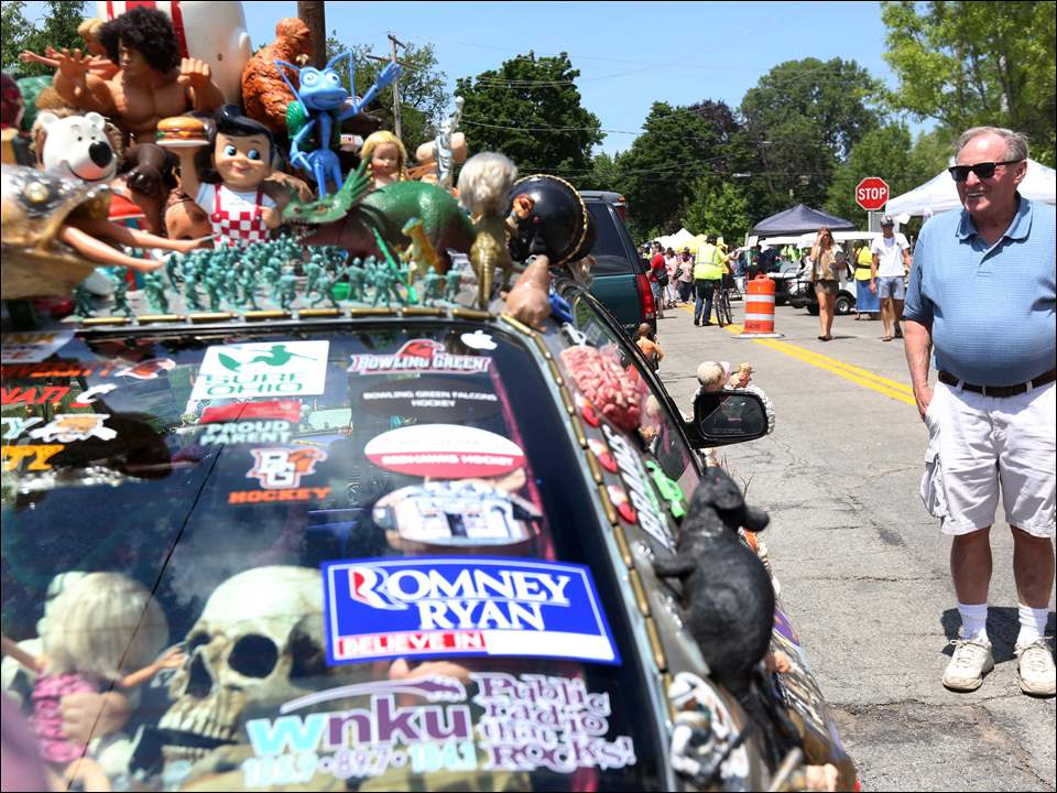 Harry Burrington, of Sylvania, takes a closer look at one of the decked out cars on display.