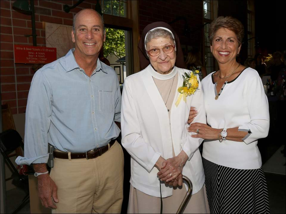 John, left, and Renee Ellis, right, stand with Sister Jane Mary Sorosiak.